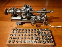 Watchmakers lathe with three jaw faceplate chuck and 60 collets